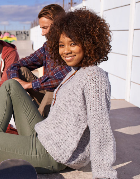 african american teen sitting on concrete steps